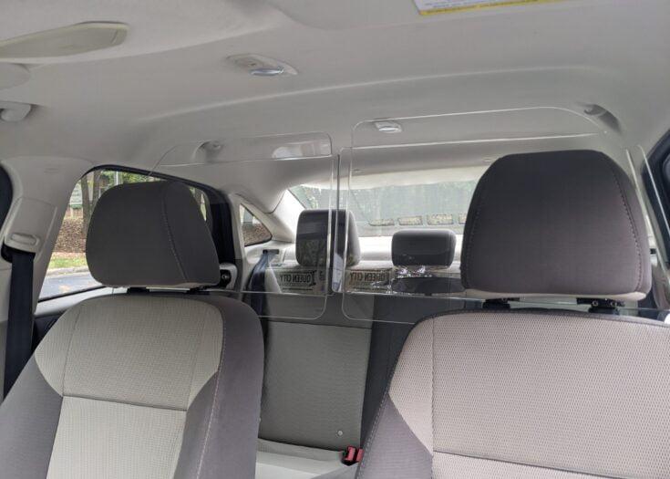 Headrest Mounted Vehicle Driver Barrier